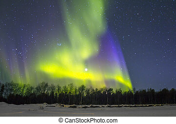 Northern Lights Aurora borealis over snowscape