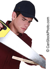 Man with a handsaw