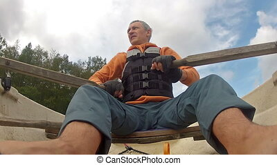Man in a Life Jacket in a Boat