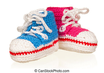 Baby booties - Handmade blue and pink baby booties isolated...