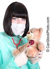 a doctor auscultating a teddy bear