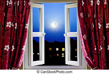 Open window to buildings at night