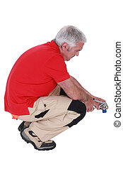 Man using pliers