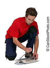 Man using tile cutter