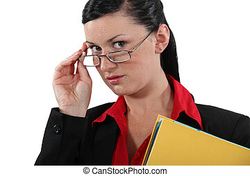 Clerical worker peering over her glasses