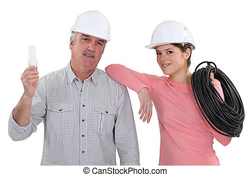 female electrician and mature mentor