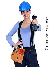 Female builder with drill