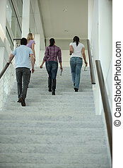 foursome walking up the stairs
