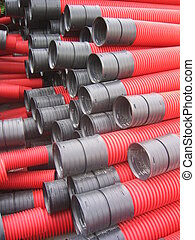 PVC Tubes - Red curvilinear pvc tubes for construction