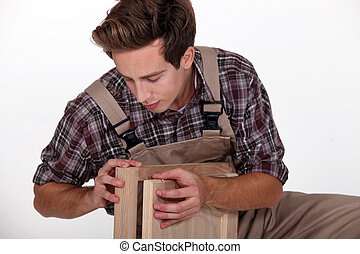 craftsman assembling wooden pieces