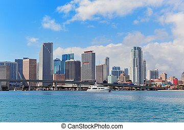 Miami skyscrapers with bridge over sea in the day
