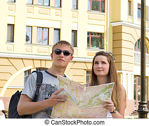 Happy tourists with a map - Happy young tourists with a map...