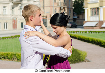 Young couple ballroom dancing - Stylish young couple holding...