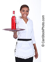 Young waitress with a bottle of rose wine and two glasses