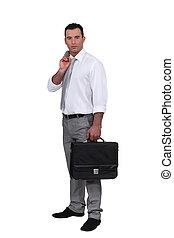 Man holding jacket over shoulder and holding briefcase