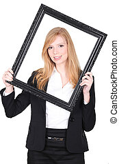 beautiful girl looking through a picture frame