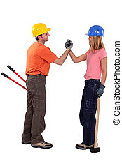 A couple of handyman shaking hands