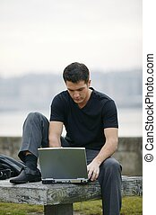 Man using his laptop outdoors