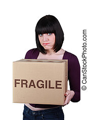 Woman with a box marked fragile