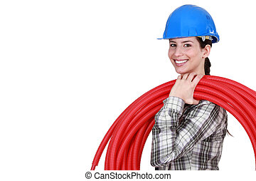female plumber carrying hose