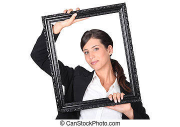 Woman behind black frame