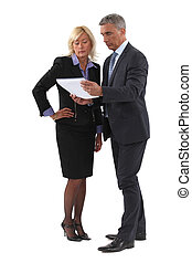 Mature business couple discussing a document