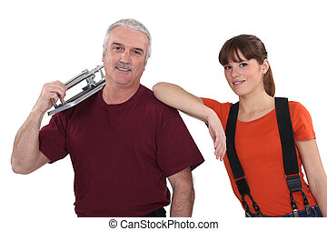 Couple with a tile cutter