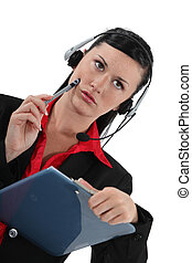 Serious woman wearing a telephone headset