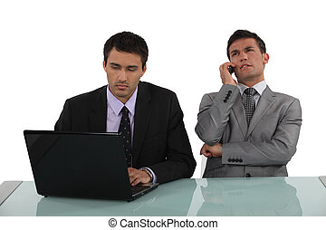 two office colleagues working together