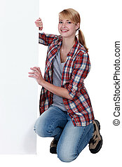 Woman holding a board left blank for your message