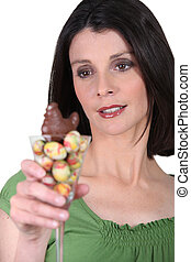 Woman with a cocktail glass full of Easter eggs