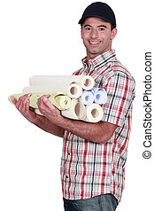 Man carrying rolls of wall-paper