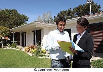 realtors in front of a house