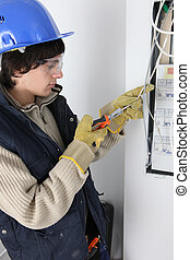 An electrician repairing a distribution board