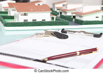 Clipboard next to a model housing estate