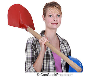 Woman with shovel over her shoulder