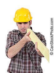 Builder with a plank of wood