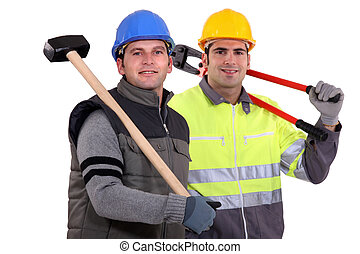 Two workers with tongs and shoulder harness