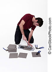 Man using tile cutter