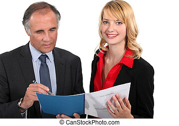 Assistant proudly showing her work to boss