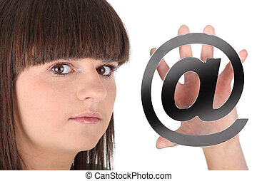 Teenage girl holding at symbol