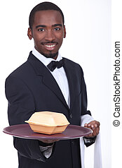 Waiter holding tray with fast food container