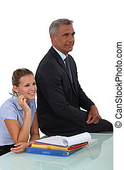 businessman and young businesswoman smiling