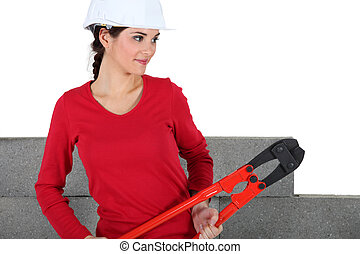 Female construction worker with boltcutters