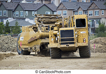 Earth Mover - A large earth moving vehicle with suburban...