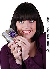 Young woman happy holding gift