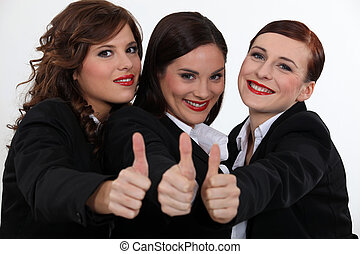 Businesswomen giving the thumbs up