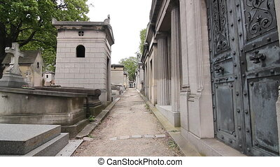 Parisian cemetery. - Gravel laneway between the gravestones...