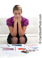 businesswoman examining graphic charts