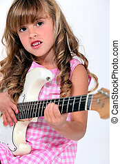 Little girl playing electric guitar
